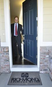 Robert Martin, vice president of finance and business development at MDC Holdings, visits a model home in the Wheatlands development in Aurora. MDC builds under the Richmond American Homes name.
