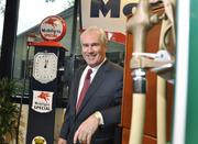 Matthew E. Meagher, Meagher Energy Advisors, is the 2012 Power Book winner for energy and natural resources.  Meagher, president, shows the antique gas pumps in his office.