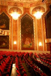 Intricate artwork adorns nearly every inch of the walls and ceilings throughout the theater.