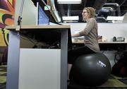 Ping Identity ranked No. 3 in the medium-size business category. Katlyn Jackson, IT associate, tries out a fitball in place of a chair at Ping Identity.