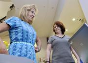 """Quest Diagnostics ranked No. 3 in the large-size business category. Kathy Ostrom, senior billing clerk; and Lucinda McCollar, billing clerk; at Quest Diagnostics, figure out their BMI at """"Blueprint for Wellness"""" health fair registration."""