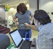 Quest Diagnostics ranked No. 3 in the large-size business category. Lucinda McCollar, billing clerk; measures her waist in order to calculate BMI (body mass index). Patrick Jenkins, environmental health and safety manager, lends a hand.