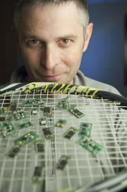 Mike Stemple, founder and CEO of Mosoro, with circuit boards that attach to items such as a tennis racket in order to monitor your swing. November 2011