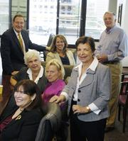"C. Jean Stewart (right front),of Holland and Hart, meets with the other members of the Denver Probate Court Volunteer Mediation Group — clockwise from upper left, Dennis Whitmer, Jennifer Shaler, Christopher Sarson, Tracy James (in the pink), Melissa Sugar and Jeanne Busacca. The group is made up of lawyers and non-lawyers who specialize in mediation, says Stewart. They offer free services to indigent people who can't afford mediation assistance. ""I am commiteed to alternative dispute resolution,"" Stewart says. She is the Outstanding Women in Business winner for Professionals."
