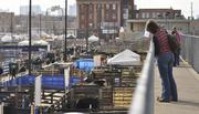 Visitors to the National Western Stock Show look onto the stockyards.