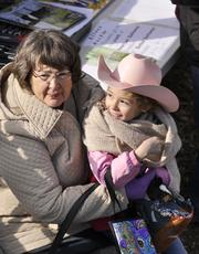 Kylie Medley, 7 of Colorado Springs sports a pink cowboy hat at the National Western Stock Show. Grandma, Mary Aten of Loveland lends support.
