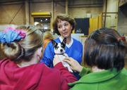 Cindy Gardelli greets fans of Zoe, her dog, at the National Western Stock Show. Gardelli was prepping for Superdogs. Left is Chelsea Jayne, 14 and Marinne Weinberger, 13.