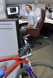 Sunrise Medical ranked No. 2 in the small-size business category. Dean Levesque, business analyst at Sunrise Medical, rides his bike to work.