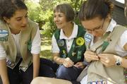"Theresa Szczurek, CEO and co-founder of Radish Systems, is troop leader for Senior Girl Scout Troop 7 in Boulder. Here, she is with her daughter, Annie Szczurek Davis, 15, and fellow girl scout, Ruth Post. Szczurek says Girl Scouts is an important organization because it helps build strong girls ""with courage, confidence and character. These girls are our future leaders."" Szczurek is the Outstanding Women in Business winner for Small Business Owners."