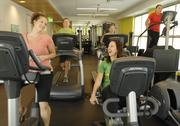 Van Gilder Insurance Co. ranked No. 2 in the medium-size business category. Employees of Van Gilder Insurance — Samantha Ricks, left, human resources generalist, and Jessica Brejcha, client associate — talk as they work out in the on-site fitness center. Van Stone, client manager, runs on the treadmill. Bethany Demeter, sales analyst for Inspirato (other building tenants are able to use the gym) uses the treadmill, while Julie Fitzgerald, client manager for Van Gilder, uses the stair stepper.