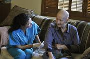 """Nurse Maureen Benjamin of Visiting Nurses Association works with Kathryn Greenlee at her home. Greenlee, who has ovarian cancer, was diagnosed in February 2011 and has been working with Benjamin since March of this year. Benjamin says, """"I get more out of it than they do and they don't even know it."""" She says she is amazed at the fortitude of her patients. August 2011"""