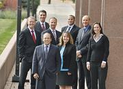 Scott Stillman, president at Wealth Concepts, in front with the team, clockwise left to right, Dustin Voag, director of financial planning; Howard Schuster, director of investments; Scott Close, senior managing director; Tyler Rainey, brokerage director; Frank Gale, managing director; Crissy Gravina, director of marketing and Debi Eggleston, managing director.