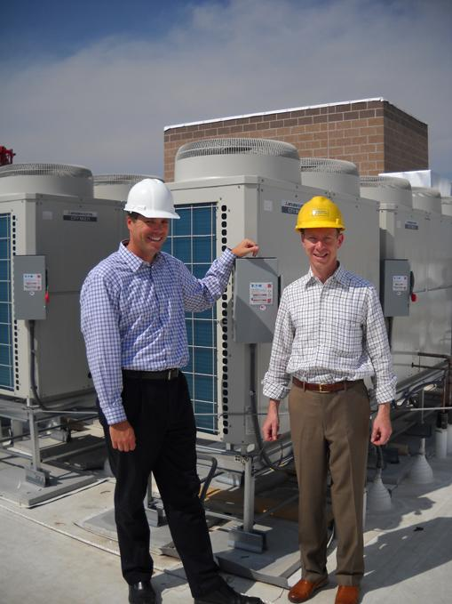 Chris Achenbach, left, and David Zucker on the roof of Zocalo Community Development Inc.'s 2020 Lawrence apartment building.