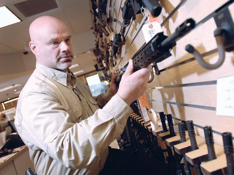 Mike Leach is director of retail operations at The Gun Store in Centennial. The store opened in February. Shootists around metro Denver are finding more places to practice their target shooting. The Gun Store has six shooting ranges.