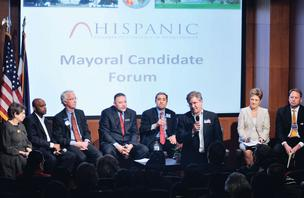 (From left) Carol Boigon, Michael Hancock, Doug Linkhart, Danny Lopez, James Mejia, Chris Romer, Theresa Spahn and Thomas Wolf participate in a recent mayoral forum conducted by the Hispanic Chamber of Commerce.