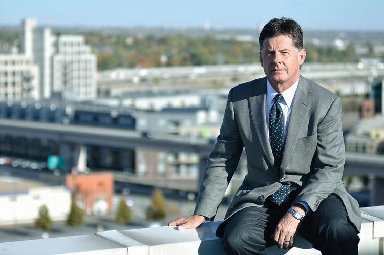 Randy Nichols, president of Nichols Partnership, sits on the roof of his office building near his new  mixed-use development at Chestnut Place and 20th Street, north of Denver Union Station. Under the current timeline, the project would be completed in late 2013.