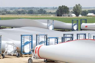 Wind-turbine blades are stored in a field next to the Vestas Wind Systems factory in Windsor.