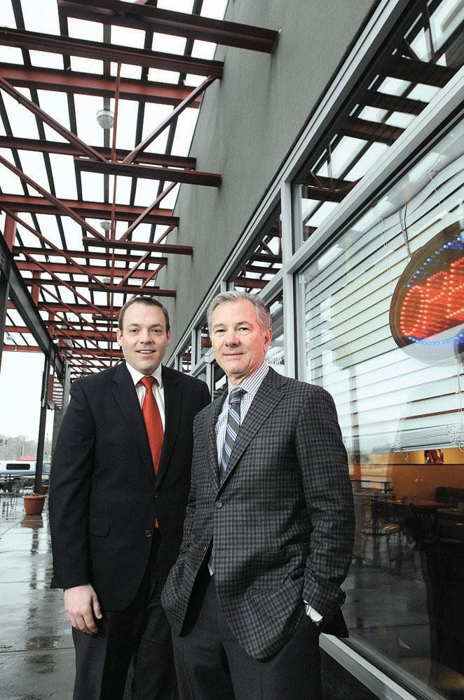 Darrin Grommeck, CFO, and Charlie Woolley, president, of St. Charles Town Co., stand outside Breakfast on the Edge at Sloan's Lakefront Market near West 20th Avenue and Sheridan Boulevard. The development, across from Sloan Lake, has been foreclosed on.