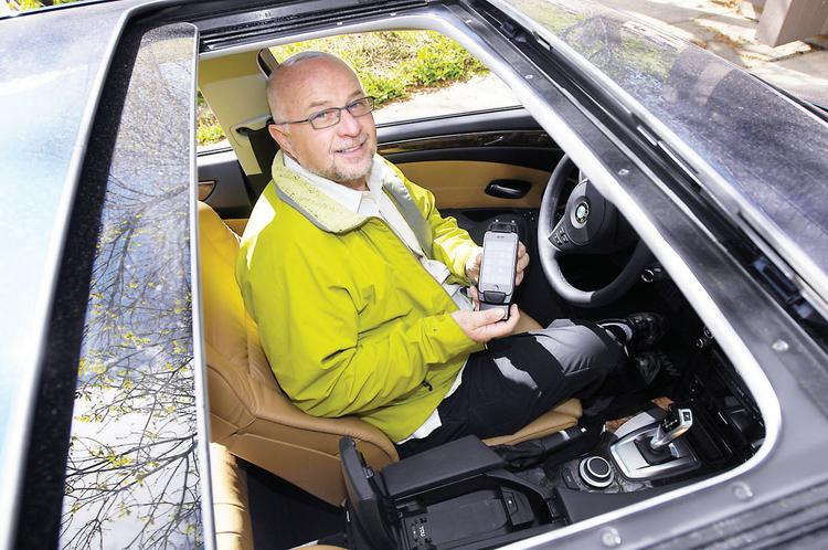Pat Kennedy, founder and CEO of Cellport Systems Inc. in Boulder, in his internet-connected vehicle with technology Cellport helped to pioneer.