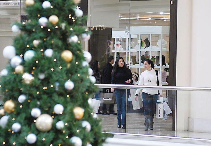Holiday shoppers make the rounds at the Cherry Creek Shopping Center in 2010. Retailers plan to hire more seasonal workers for the 2011 season to accommodate a continued rebound in consumer spending.