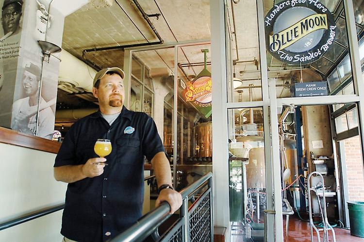 John Legnard, brewmaster at Blue Moon Brewing at the Sandlot at Coors Field, tests beer. Legnard has been with the company since the stadium opened 17 years ago.