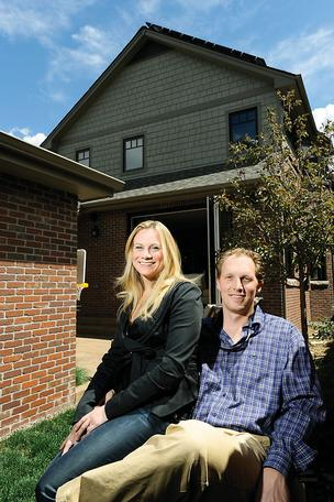 Emily Gunlock, broker and co-owner of Gunlock Hoster Group Re/Max of Cherry Creek, and husband Brad Gunlock, builder and owner of Gunlock Homes, in the backyard of their home in Washington Park. The house has many green features and quickly snagged a buyer.