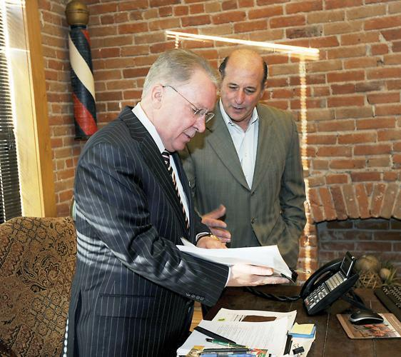 Ken Ross, former president/CEO of Pinnacol Assurance (right), with board chairman Blair Richardson in a 2011 photo.