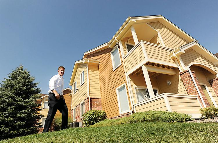 Trent Isgrig from Seagate Properties shows the newly painted apartments at Dakota at Governor's Ranch in Littleton.