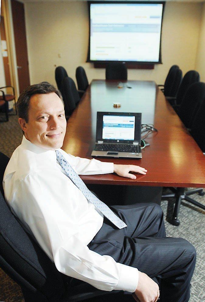 Gary Gibb, senior account executive at UnitedHealthcare, shows the company's new health care cost calculator.