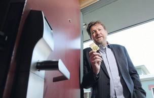 Peo Akesson, CEO and founder of Sustainable Cards, shows his product at Boulder's Quality Inn. The hotel uses the company's key cards, which are made of wood.