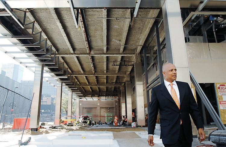 Navin Dimond, president and CEO of Stonebridge Cos., walks through the site where the former Xcel Energy building on 15th Street downtown is being transformed into a hotel.