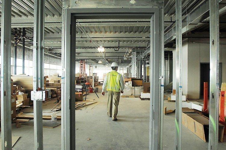 Joe Hanlin, senior project manager at Haselden Construction, walks through construction at the University of Colorado Hospital.