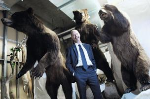 Gary Debus, president and CEO of The Wildlife Experience, in the basement with mounted grizzly bears.