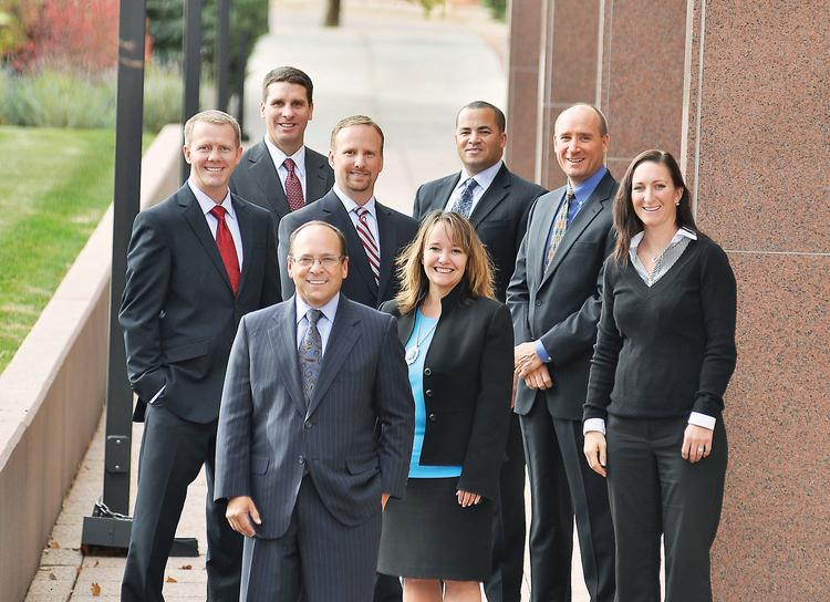 Scott Stillman (in front), president of Wealth Concepts, with, clockwise from left to right, Dustin Voag, director of financial planning; Howard Schuster, director of investments; Scott Close, senior managing director; Tyler Rainey, brokerage director; Frank Gale, managing director; Crissy Gravina, director of marketing; and Debi Eggleston, managing director.