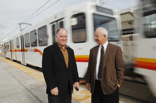 """Trey Warren, vice president, and Louis """"Dutch"""" Bansbach III, president, of Front Range Land and Development Co., at the Belleview light-rail station. The Bansbach family has owned land along the I-25 corridor since the late 1880s. Plans for developing the area that were halted when the economy collapsed in 2008 have new life today."""