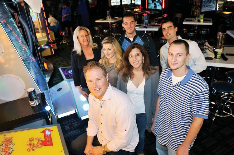Comcentric IT employees enjoy an afternoon at Dave & Busters courtesy of the company. Comcentric regularly holds team-building events, such as bowling and riding go-karts, on a work day.