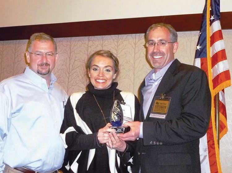 From left, Mark Latimer, CEO/president of the Associated Builders and Contractors Rocky Mountain Chapter; Emilee Cook, LEI Cos. Inc., named Young Leader of the Year; and Jeff Erker.