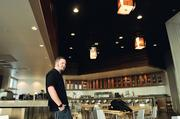 Joe Costello, a recent graduate of Metro State, visits the student-run restaurant at Springhill Suites for the first time since his lights were installed. He engineered the winning lighting design.