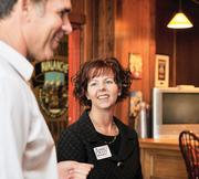 Amy Attwood, candidate for House District 28, listens to Michael Gifford, president of the Associated General Contractors of Colorado, at a fundraiser at Breckenridge Brewery.