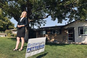 Brittany Pettersen, candidate for House District 28, stands in the front yard of her house in Lakewood, which also serves as campaign headquarters.
