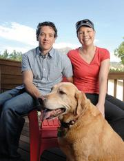 Kristy Glicksman endured breast cancer and has had her eggs frozen to maintain the possibility of having children in the future. Here she is with her husband Mike and dog, Marley, at their home in Boulder.