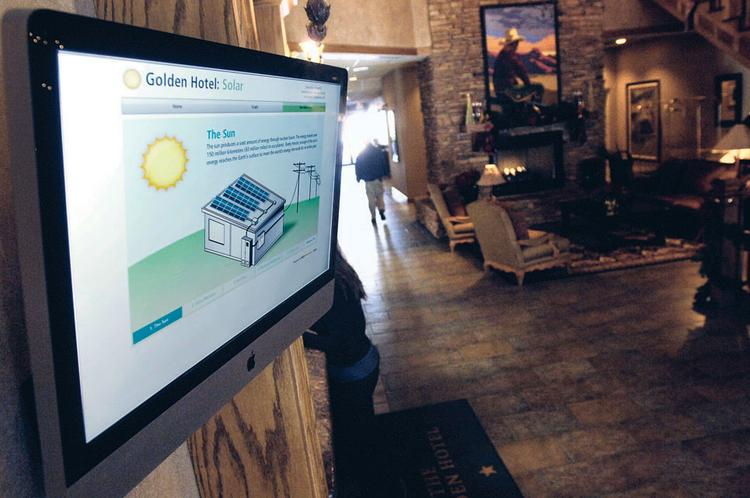 A display in the lobby of The Golden Hotel shows the facts about the hotel's use of solar panels.