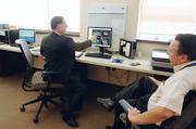 Dr. Kevin Schewe of Mountain Radiation Oncology Consultants works with physicist John Skrobola.