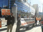 Backers of Amendment 64 line up outside of the Colorado Convention Center as business and government leaders hold a news conference to oppose the ballot initiative on Oct. 15.
