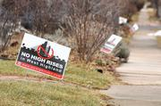 """No High Rises"" signs in Highlands are posted in yards near West Moncrieff Place and Lowell Boulevard. An advocacy group has distributed these yard signs, circulated a petition, created a Facebook page and criticized RedPeak's plans as ""irresponsible development."""