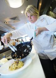 Panzano's executive chef, Elise Wiggins, prepares Carbonara a la Panzano Tagliatelle made with pancetta from Tender Belly. She says she loves working with Tender Belly because she can order specific breeds of hog known for having a lighter fat that keeps the meat more moist.