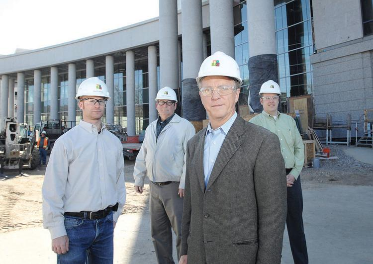 Outside the Ralph Carr Judicial Center, from Encore Electric, left to right, Scott Larson, project superintendent; Stan Gittens, senior project manager; Willis Wiedel, president; and Jay Packard, preconstruction manager.