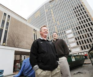 Mortenson Construction executives Dale Heter and John McCorkle stand outside the Byron G. Rogers Federal Office Building and U.S. Courthouse.