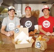 Brad Arguello, Alex Gschwend and Henry Dematteis are co-founders of The Über Sausage at 2730 E. Colfax Ave., which serves gourmet sausage sandwiches. Arguello's parents, Tony and Barb Arguello, co-owned Mataam Fez Moroccan restaurant, and Gschwend's grandfather had a catering company in Capitol Hill.