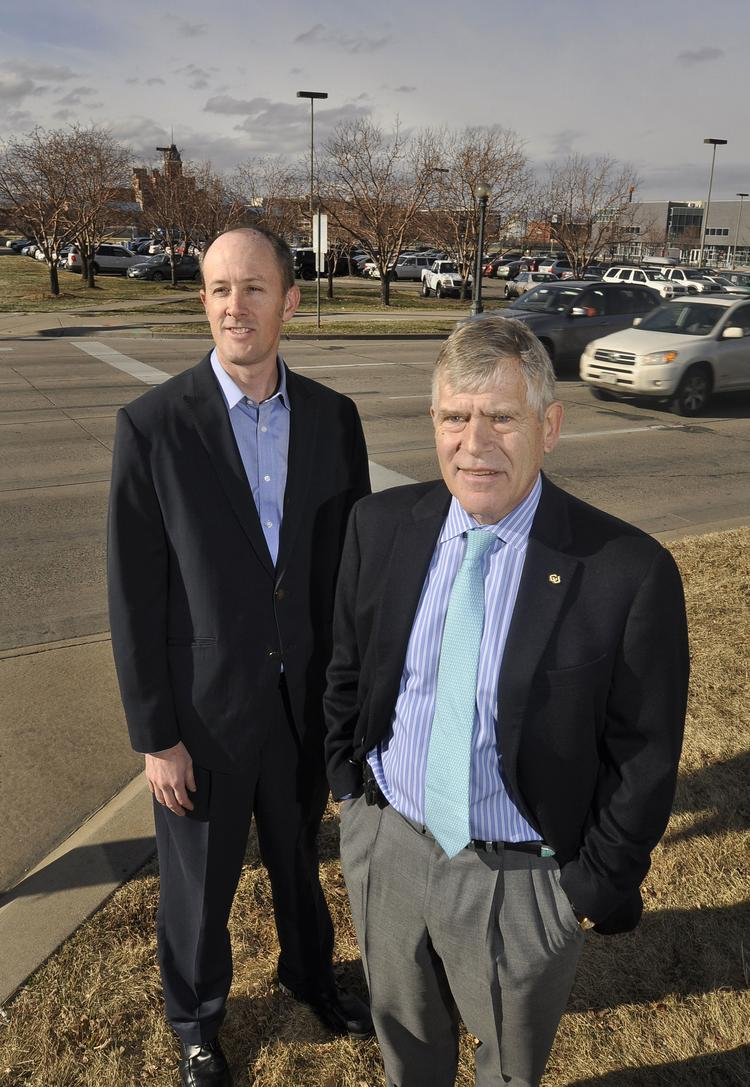 University of Colorado Denver project manager Cary Weatherford (left) and Chancellor Don Elliman near the site where a new building will be constructed at Speer Boulevard and Larimer Street.